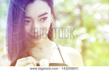 sweet dreamy close up portrait of charming woman in garden soft focus