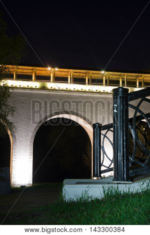 Old Bridge In City Park At Night
