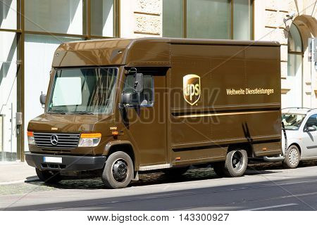 FRANKFURT AM MAIN GERMANY - AUGUST 7 2015: UPS van parked on a street in the city center. UPS is one of largest package delivery companies worldwide.