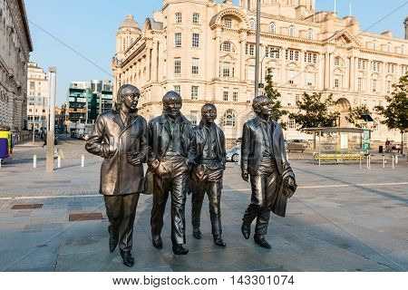 LIVERPOOL, UK - AUGUST 18:  Bronze statue of the four Liverpool Beatles stands on Liverpool Waterfront by sculpture Andrew Edwards.  Fish eye perspective.  August 18, 2016 in Liverpool.