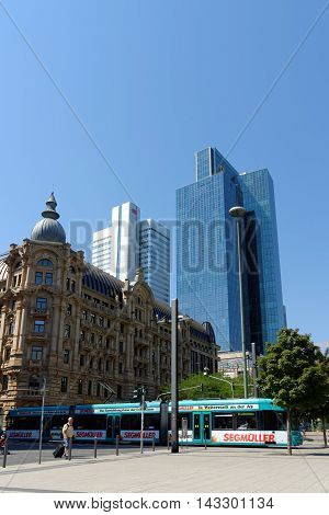 FRANKFURT AM MAIN GERMANY - AUGUST 7 2015: A tramcar on Willy-Bradt-Platz with the Silberturm (Silver Tower) and Gallileo skyscrapers in the background.