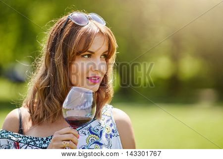 Girl Savouring Red Wine