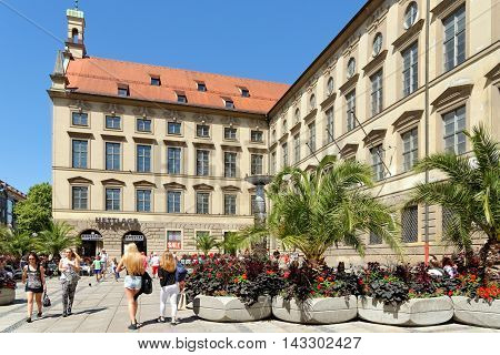 MUNICH GERMANY - AUGUST 3 2015: Neuhauser street the main and busiest shopping street and one of the oldest in Munich.