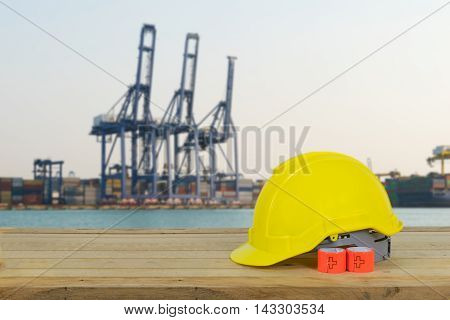 No Huge container cargo ship on harbor due to wait new employee wearing yellow Safety Helmet