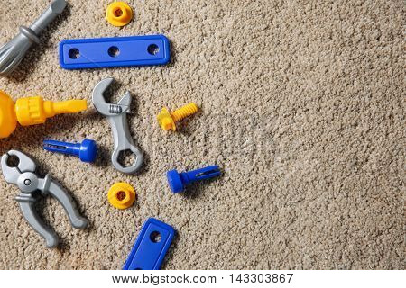 Set of plastic children toys on carpet, top view