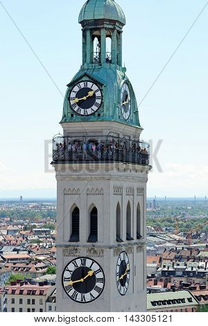 MUNICH GERMANY - AUGUST 3 2015: Close up of the bell tower of St. Peter's Church a Roman Catholic church the oldest one in the district.