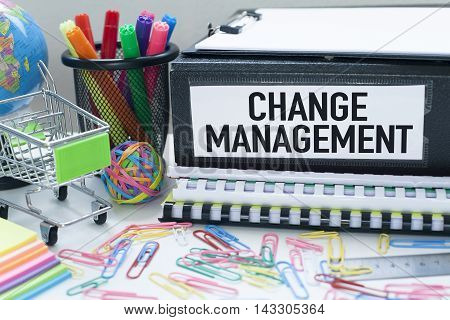 Change management concept with files in office