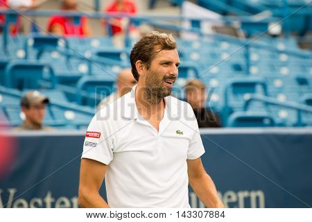 Mason Ohio - August 15 2016: Julien Benneteau in a first round match at the Western and Southern Open in Mason Ohio on August 15 2016. Bennetaue upset David Ferrer.
