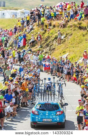 Col du Glandon France - July 23 2015: Technical car follows the cyclist Simon Yates of Orica-GreenEDGE Team riding on the road to Col du Glandon in Alps during the stage 18 of Le Tour de France 2015.