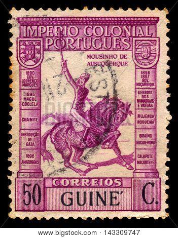 Portuguese Guinea - CIRCA 1938: a stamp printed in Portugal shows Joaquim Augusto Mouzinho de Albuquerque, was a portuguese cavalry officer, circa 1938