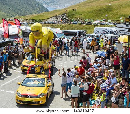 Col du Glandon France - July 23 2015: LCL characteristic vehicles during the passing of the Publicity Caravan on Col du Glandon in Alps during the stage 18 of Le Tour de France 2015. LCL was the largest bank in France and sponsored continuosly the TDF dur