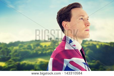 A thoughtful businessman looking away against digitally generated great britain national flag