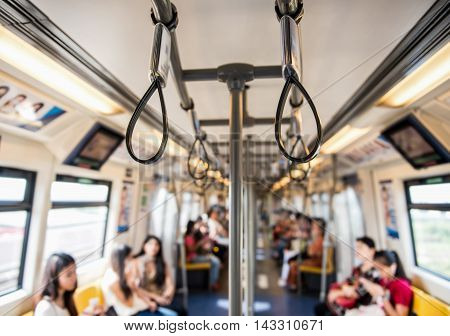 Handles for standing passenger inside train, Thailand