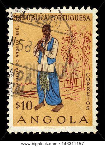 ANGOLA - CIRCA 1957: A stamp printed in Angola shows flutist Andulo, series angolan people, circa 1957