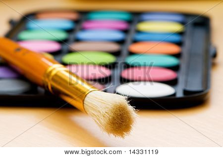 Art concept with painters palette and paint brush