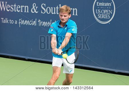 Mason Ohio - August 16 2016: David Goffin in a match at the Western and Southern Open in Mason Ohio on August 16 2016.