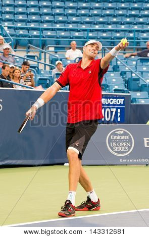 Mason Ohio - August 16 2016: John Isner in a match at the Western and Southern Open in Mason Ohio on August 16 2016.