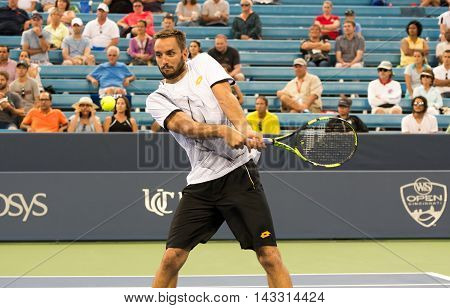 Mason Ohio - August 15 2016: Victor Troicki in a first round match at the Western and Southern Open in Mason Ohio on August 15 2016.