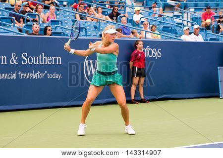 Mason Ohio - August 13 2016: Carina Wittoeft in a qualifying match versus Eugenie Bouchard at the Western and Southern Open in Mason Ohio on August 13 2016.