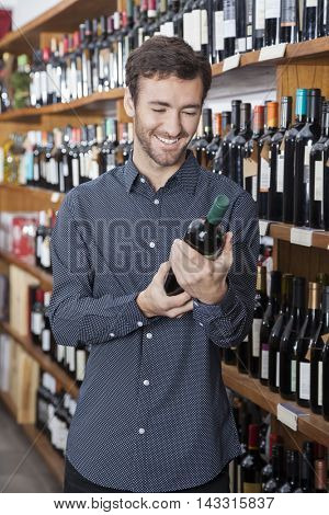 Customer Holding Wine Bottle In Store