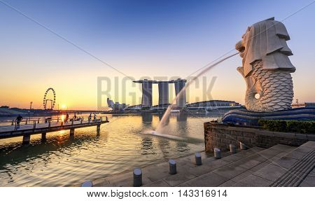 SINGAPORE-APR 21 : The Merlion and the Marina Bay Sands Resort Hotel billed as the world's most expensive standalone casino property at S$8 billion on APR 21 2015 in Singapore.