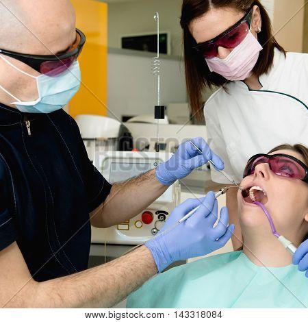 Laser dental surgery, toned image, horizontal image