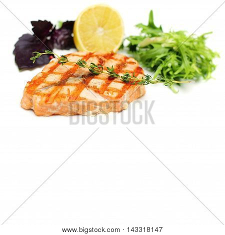Gourmet Fish Steak with Lemon and Herbs. Restaurant Food Background with Copy Space