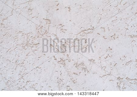 Background of a white stucco coated and painted exterior rough cast of cement and concrete wall texture decorative rustic coating