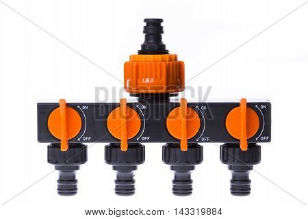 Plastic 4-channel distributor to supply water on a white background