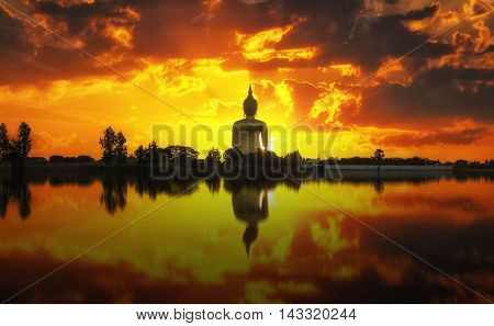 The Big Golden Buddha on sunrise at Wat Muang Ang Thong Thailand