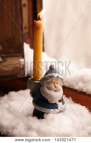 Support under a candle in the form of toy Father Frost