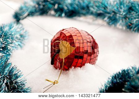 Fir-tree toy in the form of red apple from a glass mosaic