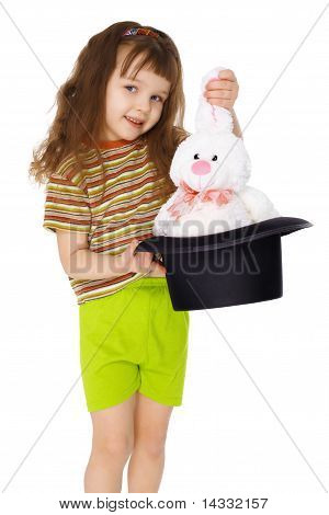 Child Gets Rabbit Out Of A Hat Like Magician On White
