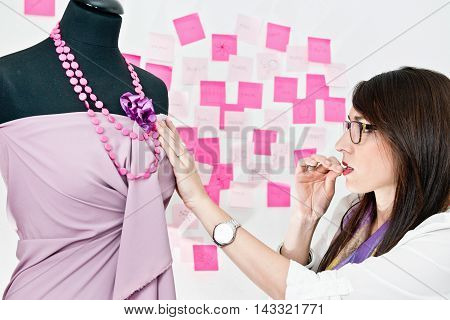 Fashion designer working on prom dress, toned image
