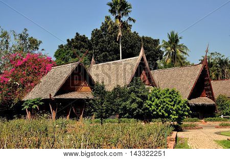Sampan Thailand - January 10 2010: A row of traditional thatched wooden Thai houses at the Riverside Rose Garden & Thai Village *