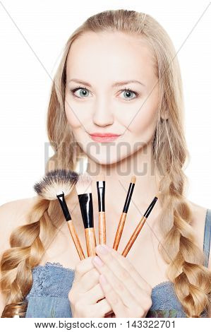 Fashion Model and Makeup Brushes on white background