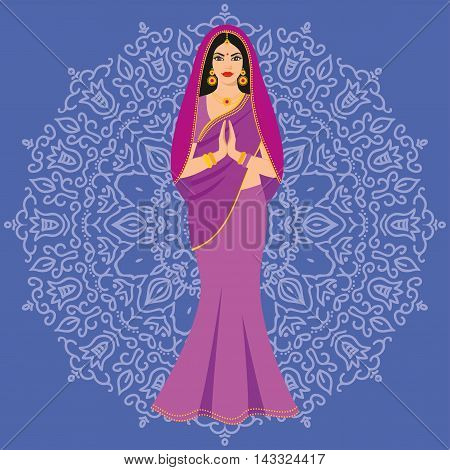 Beautiful Indian brunette young woman in colorful sari against the background of the ornament