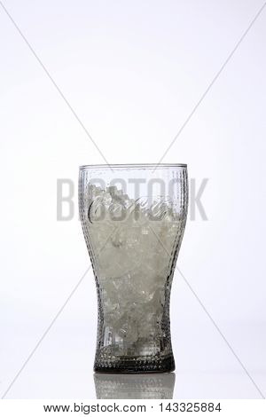 Kuala Lumpur,Malaysia,8th Aug 2016,A empty glass of coca cola. Coca Cola drinks are produced and manufactured by The Coca-Cola Company, an American multinational beverage corporation