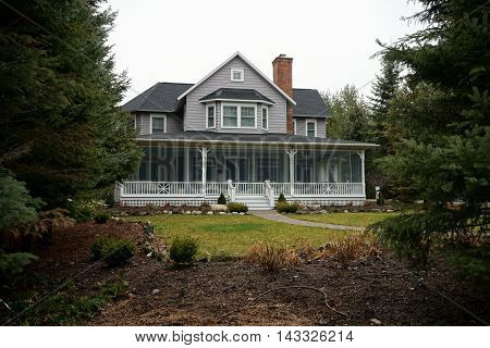 WEQUETONSING, MICHIGAN / UNITED STATES - DECEMBER 22, 2015: A large home on Pennsylvania Avenue in Wequetonsing.