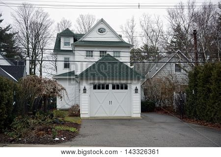 A white home with an attached garage on Pennsylvania Avenue in Wequetonsing, Michigan.