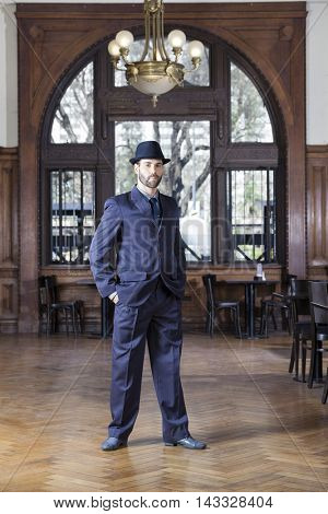 Portrait Of Confident Male Tango Dancer Standing In Restaurant