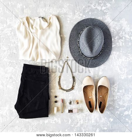 feminine summer clothes and accessories collage on concrete background. flat lay top view