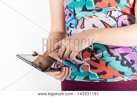 Tablet computer. Woman using digital tablet computer PC isolated on white background. Woman with finger on touch screen display