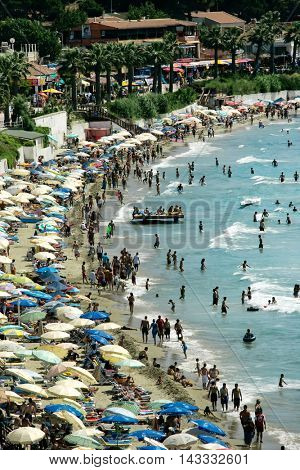 KUSADASI, Turkey - MAY 20, 2016: People on beach of Kusadasi. Editorial image
