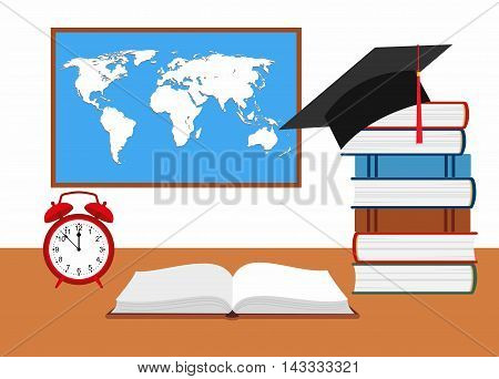 desk with watch, hat graduate and stack of books against the background of the world map
