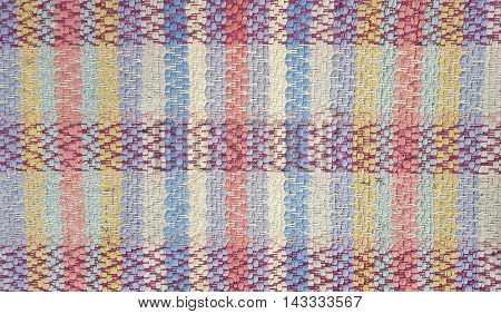Close up of pastel plaid woven rug