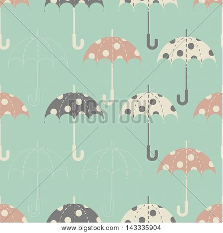 Seamless texture. Autumn. The depicts the umbrellas of the same size, with the pattern on them in the form of circles. Umbrella in three colors: grey, pink and beige. Umbrellas on a green background.