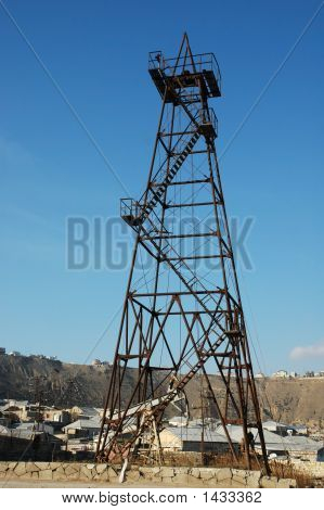 Old Oil Derrick During Bright Summer Day