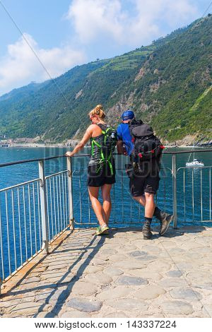 Hiking Couple Standing At The Coast Of The Cinqueterre, Italy