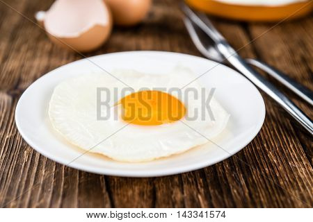 Wooden Table With Fried Eggs (selective Focus)